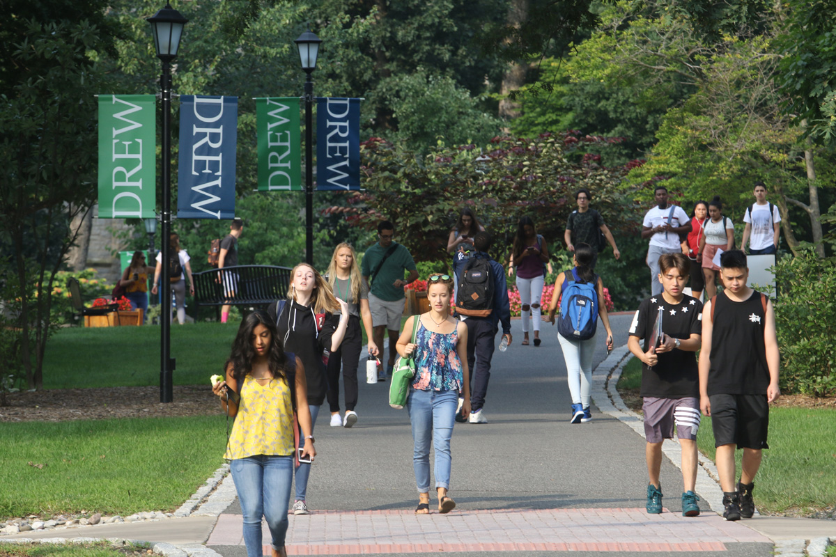 Drew students walking on a campus path