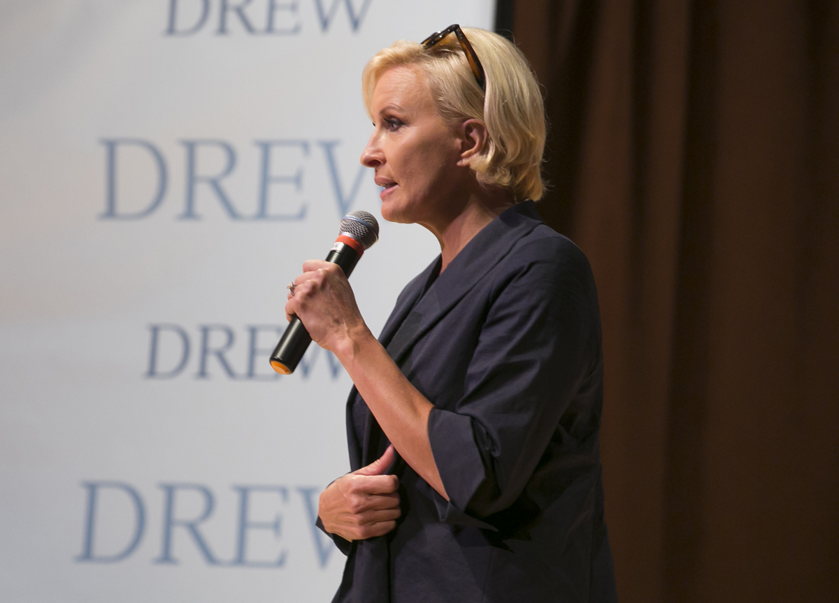 Mika Brzezinski standing with a mic in hand