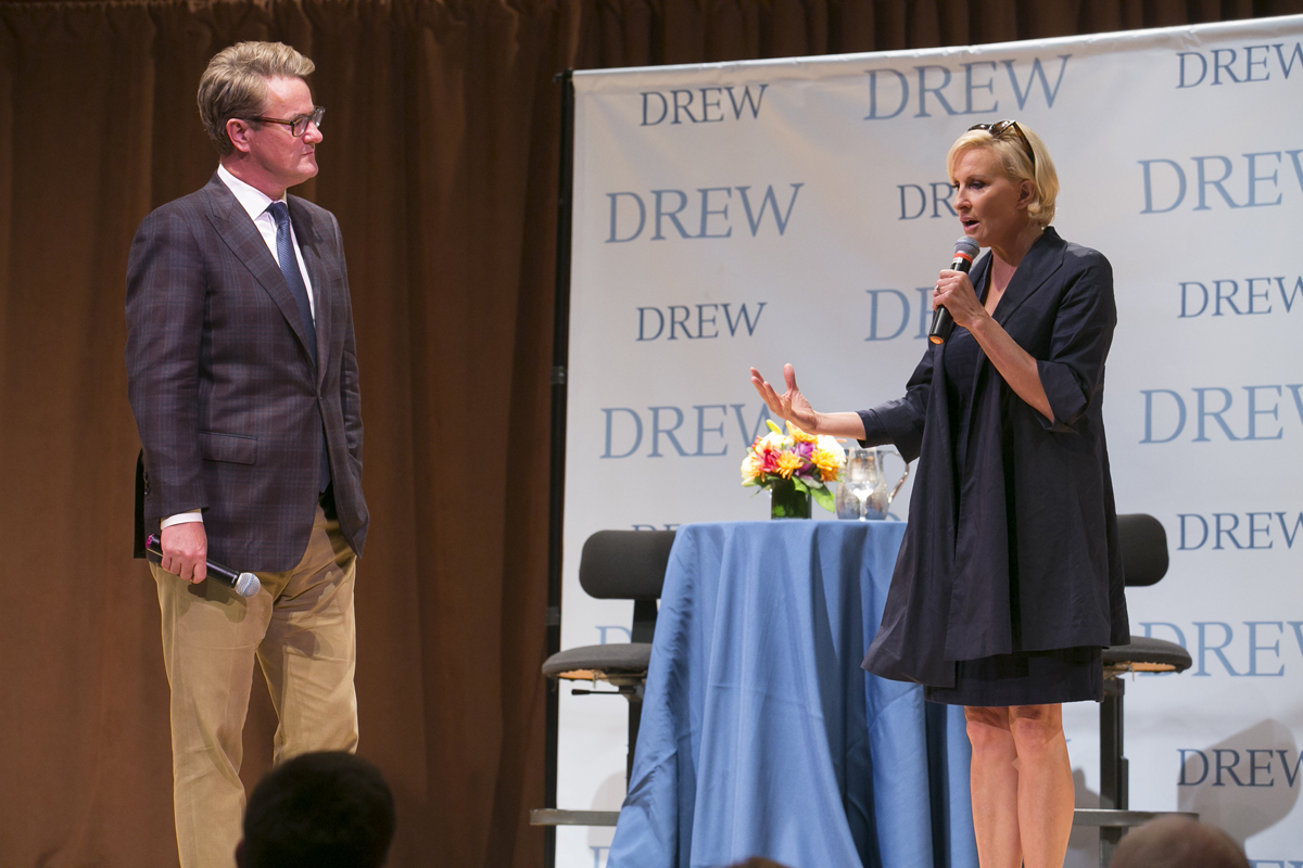 Joe Scarborough and Mika Brzezinski standing the stage of The Concert Hall at Drew