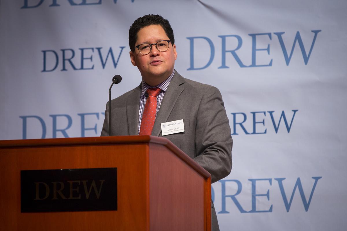 Dean Javier Viera speaking behind a lectern