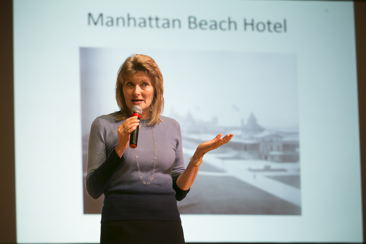 Jennifer Egan standing with a microphone in her hand