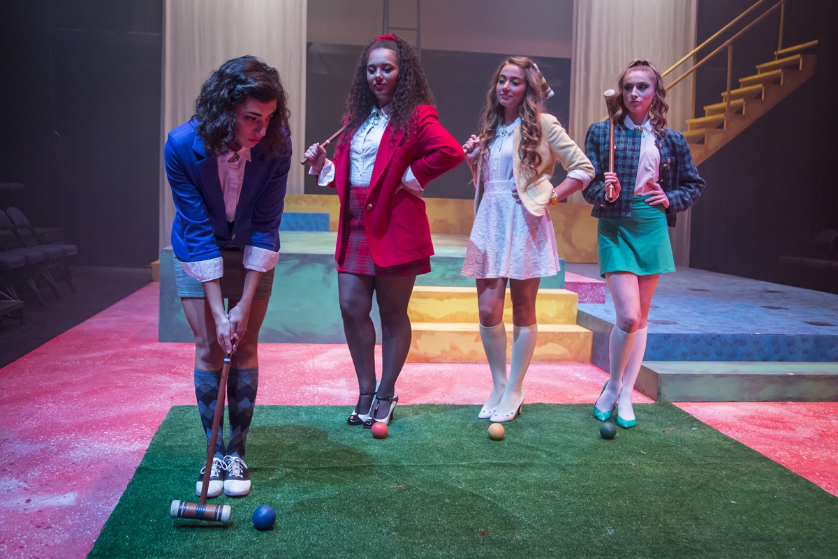 Four women play crochet in a scene from Heathers: The Musical