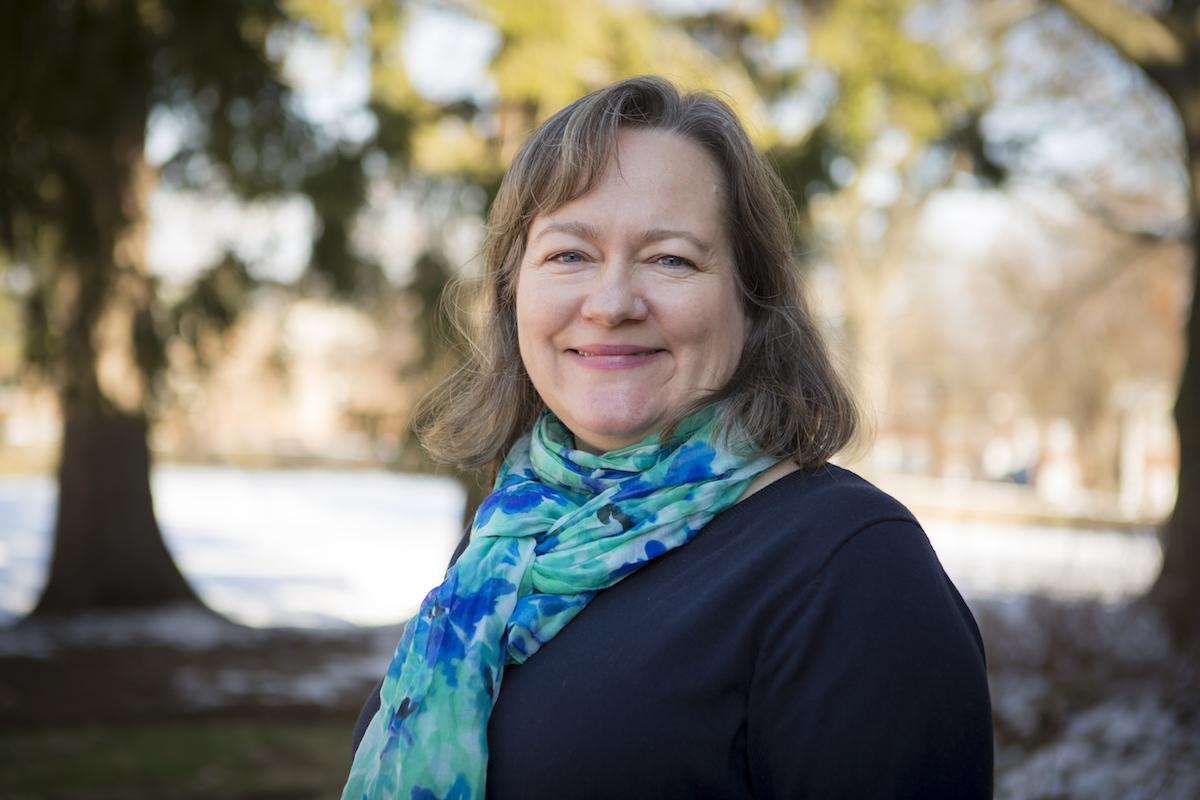 A smiling Professor Sarah Abramowitz on campus
