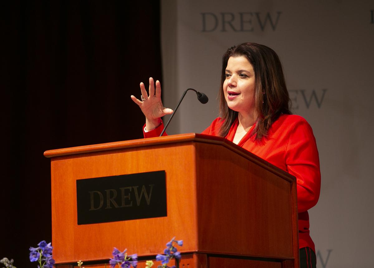 Ana Navarro speaking behind a Drew lectern