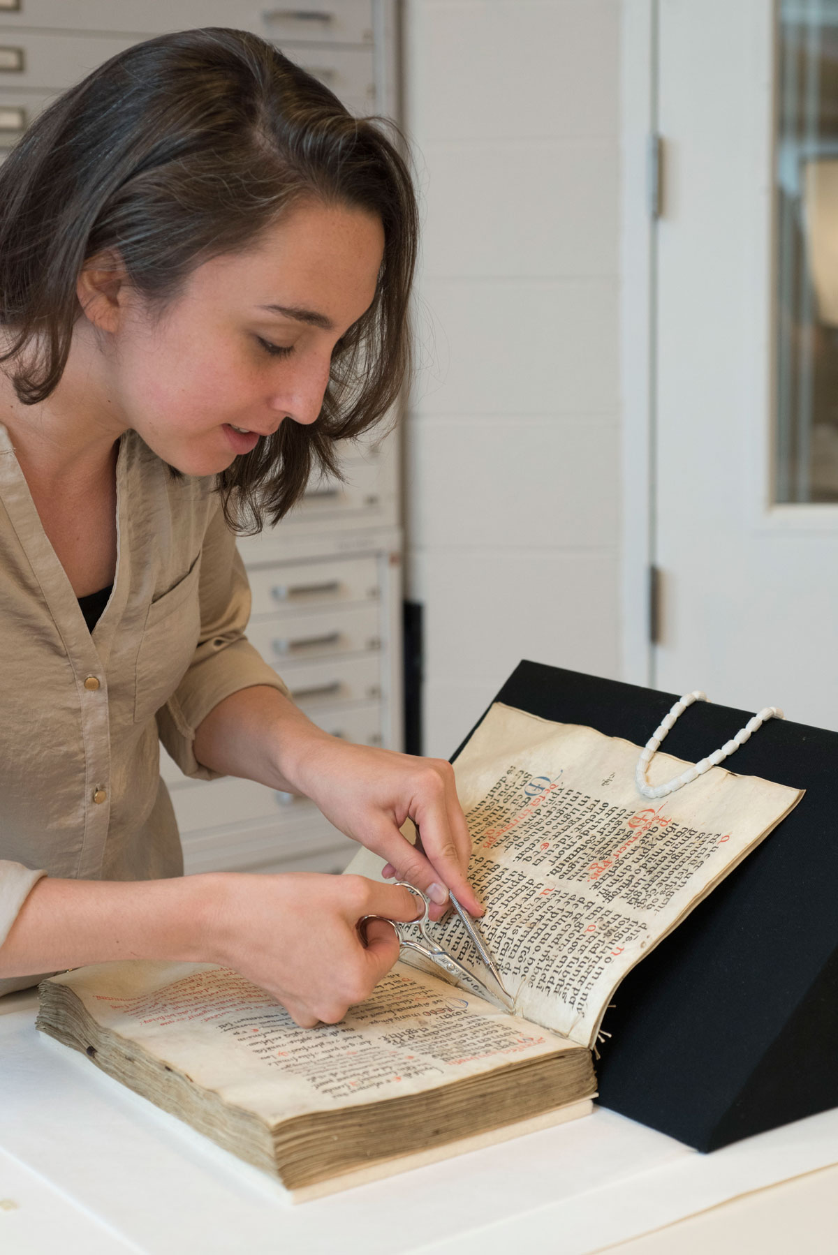 Catherine Magee doing preservation work on a book