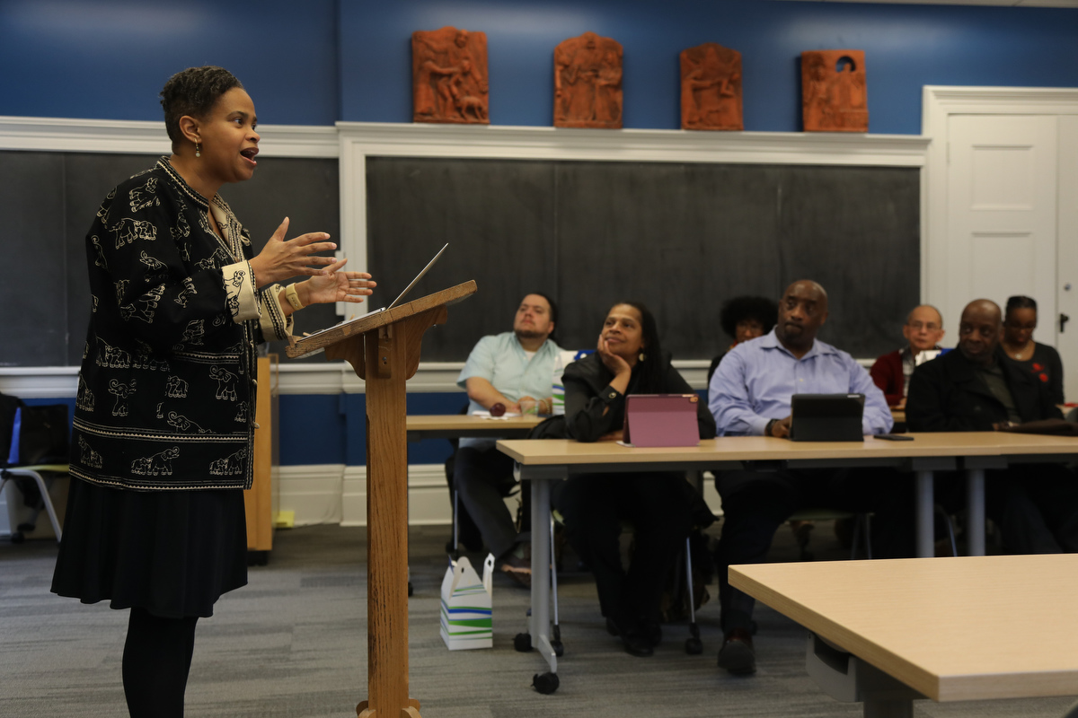 The Rev. Dr. Leslie Callahan speaking in a classroom as students look on