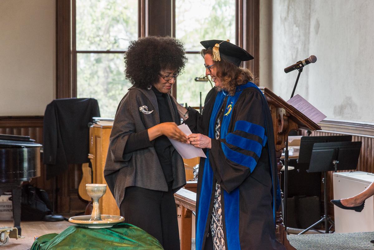 Sharon Williams receives an award from Professor Danna Nolan Fewell