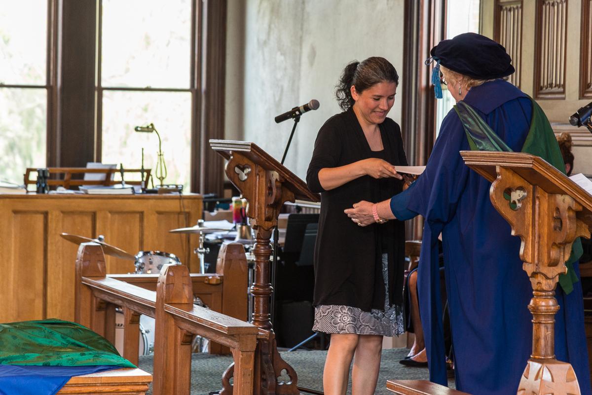 Yesenia Palomino receiving an award