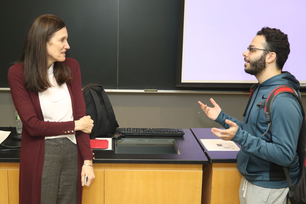 Scientist talking to male student