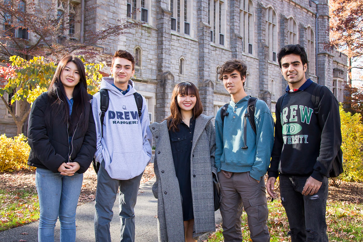 Group of international students standing in front of S.W. Bowne Hall