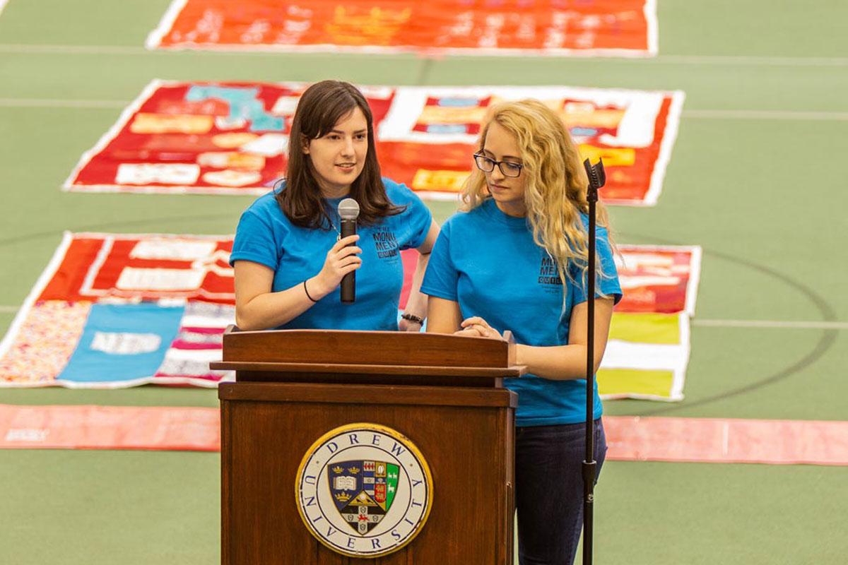 Cassie Allen and Katie Sparks behind a lectern