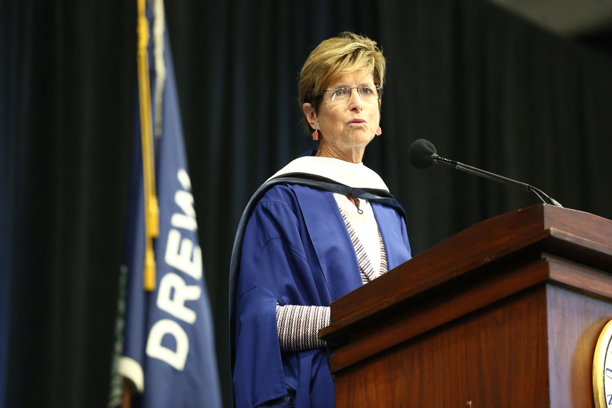 Christine Todd Whitman speaking behind a lectern