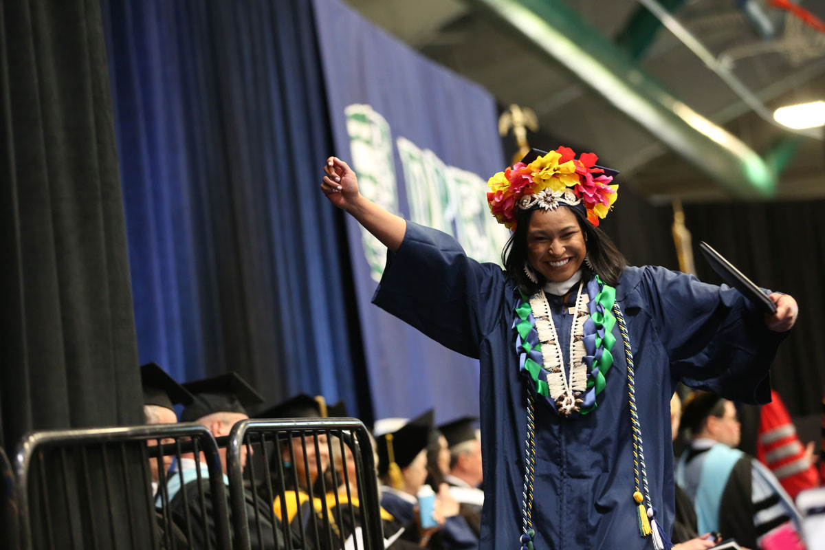 Woman celebrating after receiving a diploma
