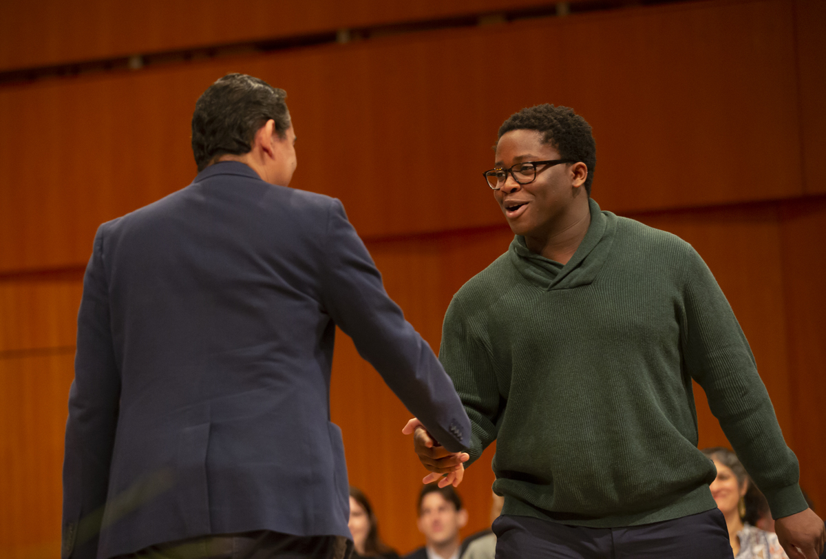Professor Tomás Morín shakes hands with Perry Asibey-Bonsu
