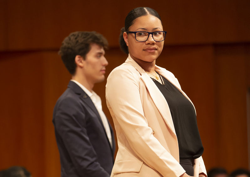Emilio Peñate and Janaya Reeves standing on stage