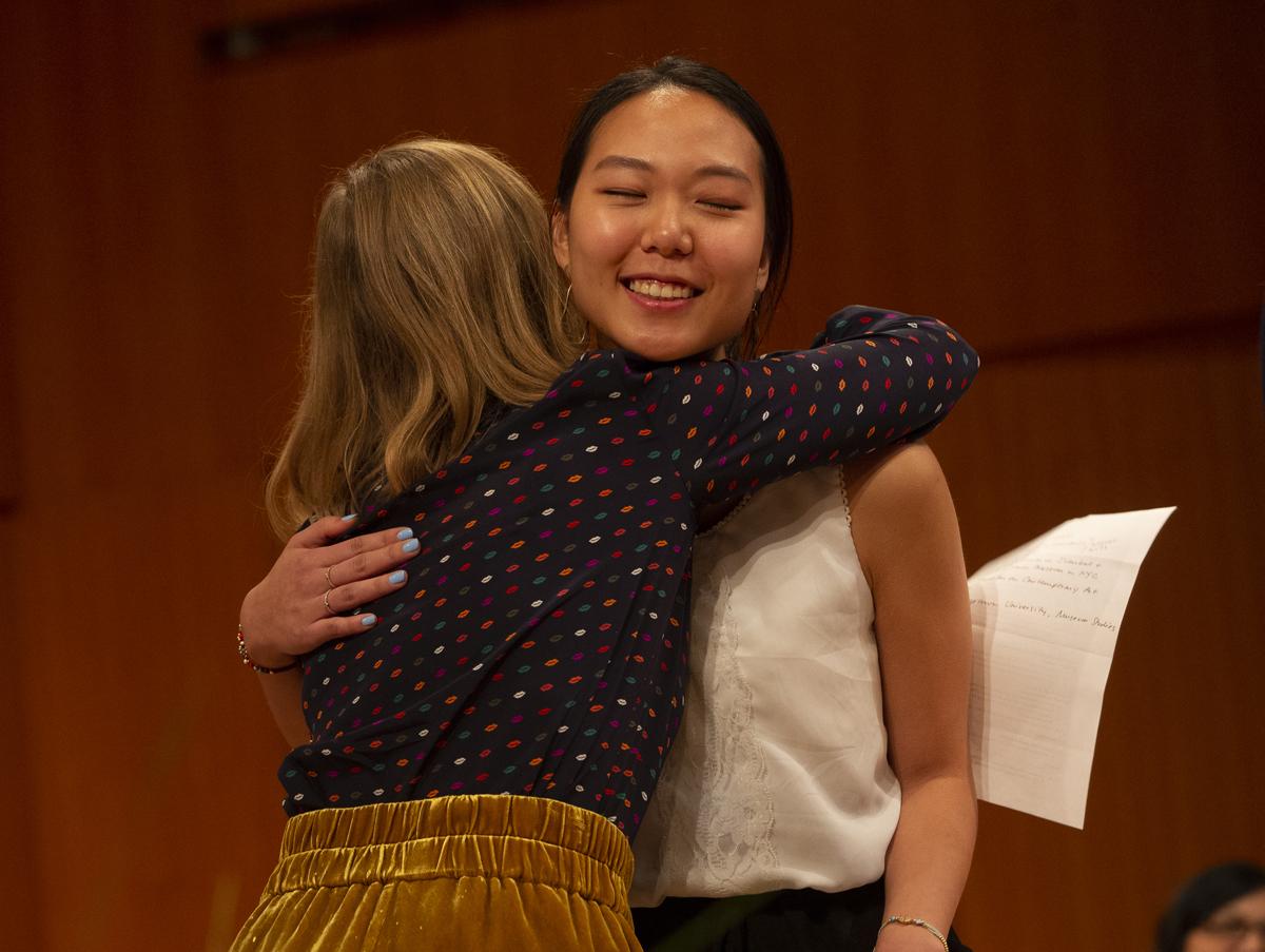 Professor Kimberly Rhodes hugs Inji Kim