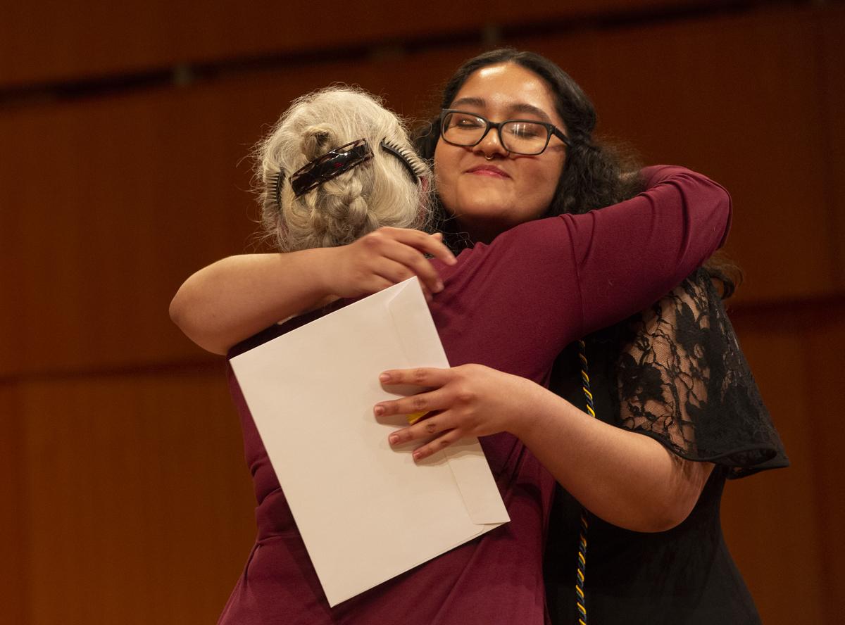 Professor Wendy Kolmar hugs Aurie Flores
