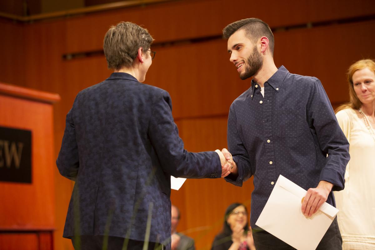Provost Debra Liebowitz shaking hands with Alexander Pearce