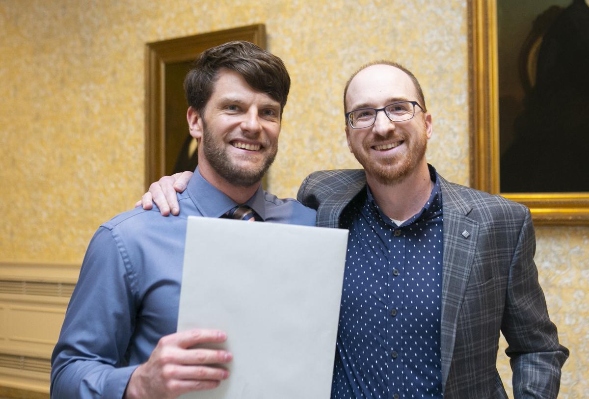 Award winner Daniel Michalak standing next to fellow graduate student Brian Shetler