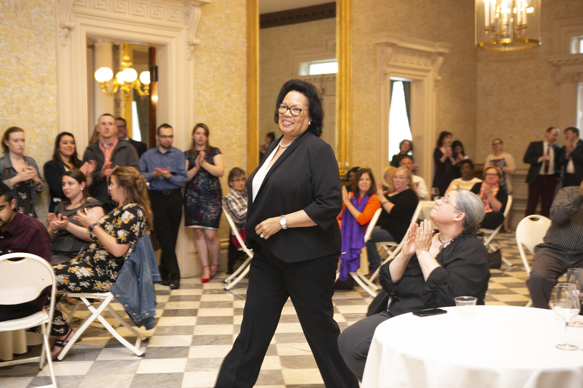 Brenda Hall smiling as she walks up to receive an award