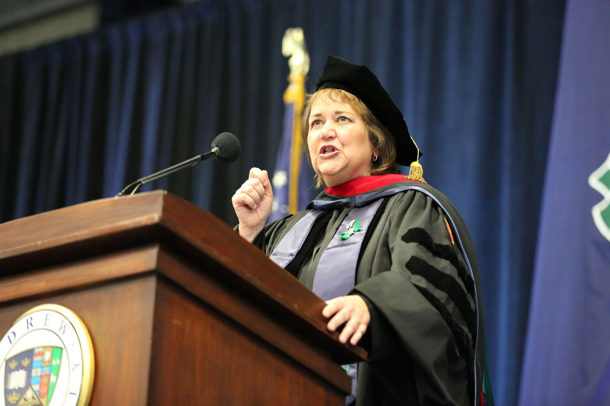Karen Oliveto speaking behind a lectern