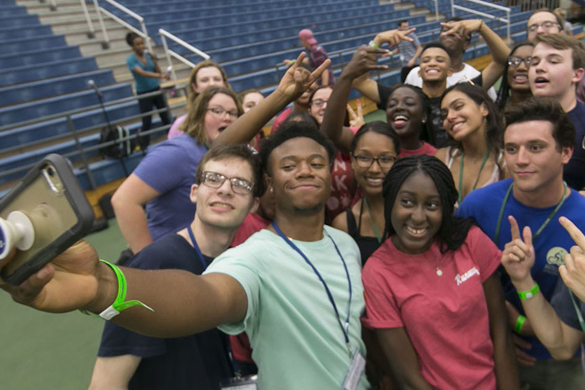 Group of first-year students taking a selfie inside Simon Forum