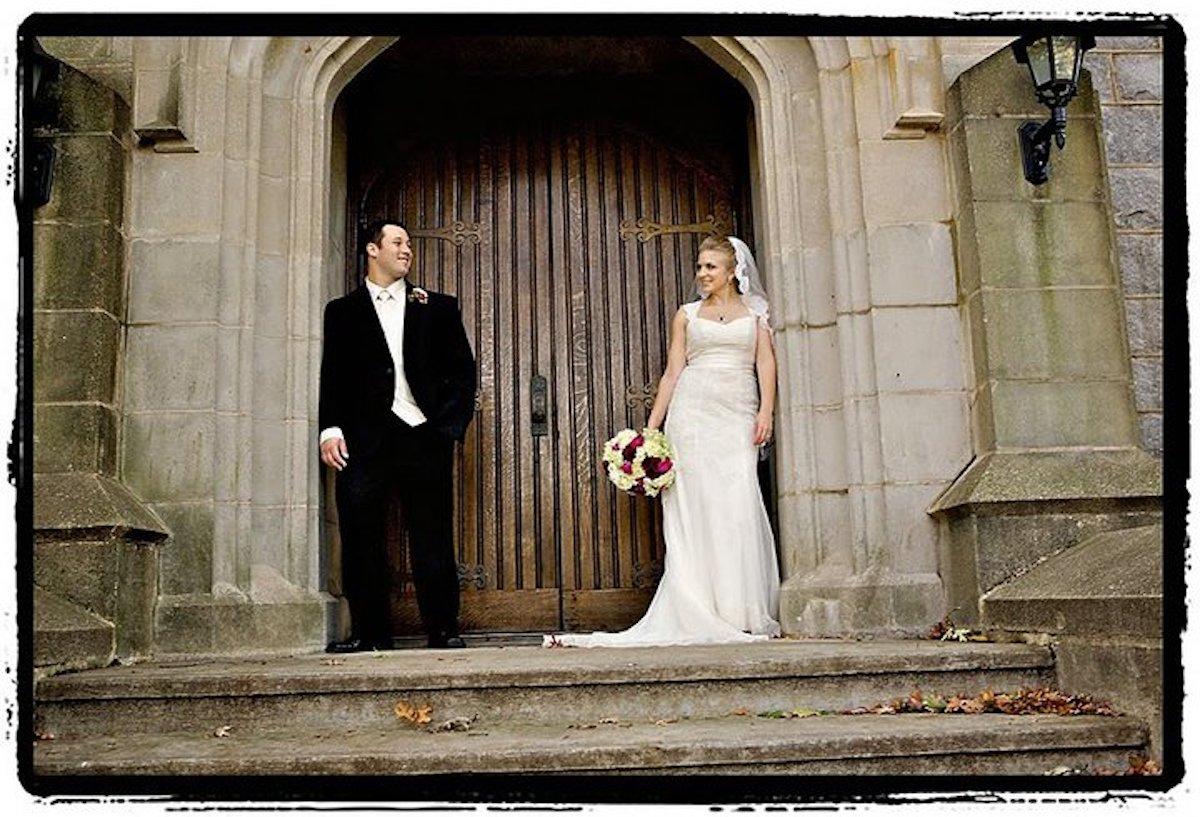 Jason Kenworthy and Nina Dziopa dressed in wedding clothes outside Craig Chapel
