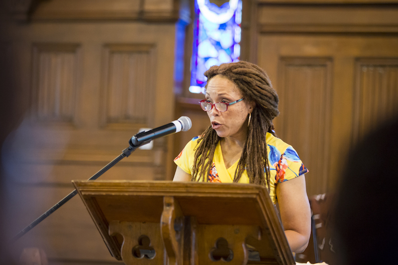 Sophfronia Scott speaking at a lectern