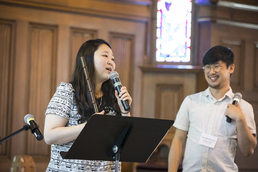 Sooha Na and YoungKwang Jun speaking at a lectern